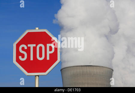 Symbolic image against nuclear power, stop sign in front of a cooling tower of the Gundremmingen nuclear power plant, - Stock Photo