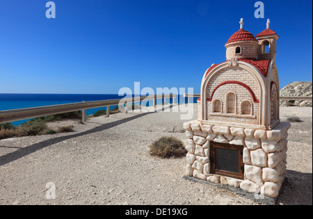Cyprus, small chapel in a parking lot near Petra tou Romiou, coastal road, parking - Stock Photo