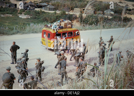 Vietnam War 1957 - 1975, American soldiers and Vietnamese minibus on a road near a bivouac, South Vietnam, 1965, - Stock Photo