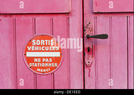 No parking sign on red painted french door in Honfleur Normandy France - Stock Photo