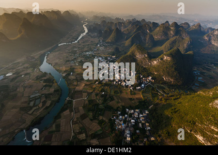Aerial view of Li River valley towns and karst peaks in Henan Province China - Stock Photo