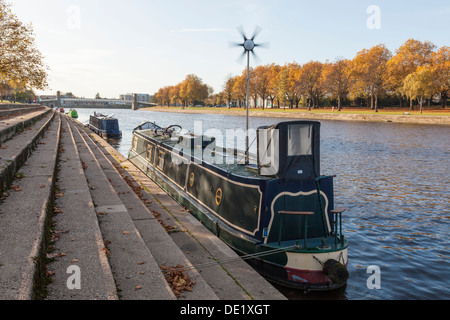 Boat with wind generator. Narrowboat using a wind turbine for power while moored on the River Trent, Nottinghamshire, - Stock Photo