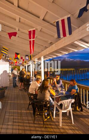 Eating dinner outside a lovely evening at the Beachcomber Inn, near Petersburg, Southeast Alaska USA - Stock Photo