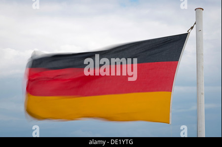 German flag fluttering in the wind, Germany - Stock Photo