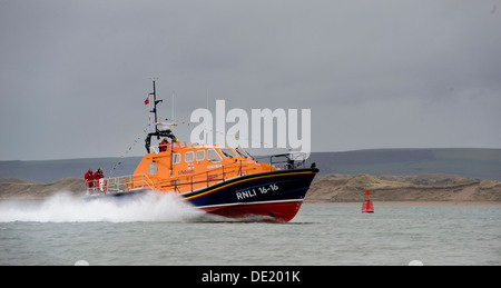 The RNLI Tamar-class lifeboat Mollie Hunt in action off the Appledore on the North Devon coast - Stock Photo