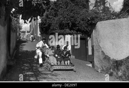 geography / travel, Portugal, isle Madeira, people, tourists are pushed along the street in a sledge, Funchal, picture - Stock Photo