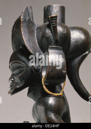 Chief holding a sanza, a musical instrument of the ideophone family, with metal keys and gourd resonator. - Stock Photo
