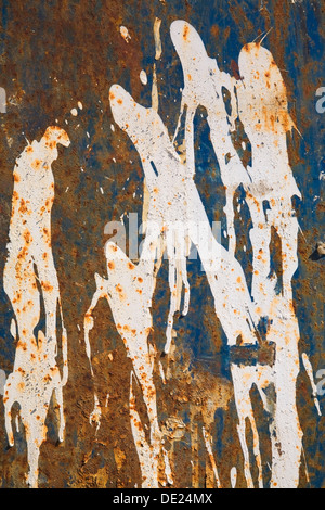 Rust and white paint patterns on a ferrous metal surface, Laval, Quebec Province, Canada - Stock Photo