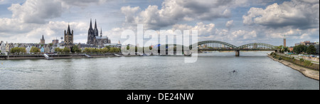 A wide HDR panorama of the Germany city of Cologne (Köln) and the river Rhine - Stock Photo