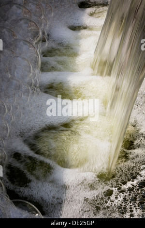 Close-up of a stream of water and air bubbles in a basin, Quebec Province, Canada - Stock Photo