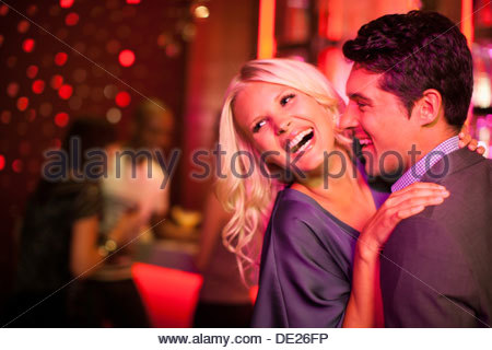 Couple hugging in nightclub - Stock Photo