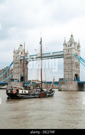 London, UK. 10th Sep, 2013. Tower Bridge, London. The bridge opens as two classic boats arrive during the Thames - Stock Photo
