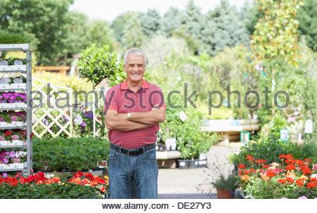 Mature man standing in garden - Stock Photo