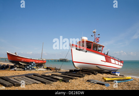 Deal Kent England UK Fishing boats on shingle beach with pier behind - Stock Photo
