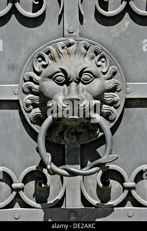 Lion head as door knocker on the iron doors of the Bavarian National Museum in Munich, Bavaria