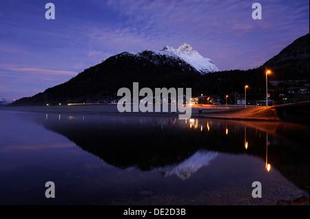 Lake Silvaplana with village of Silvaplana at dawn, St Moritz, Engadine, Grisons, Switzerland, Europe - Stock Photo