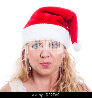 Surprised woman in Christmas hat, isolated on white background. - Stock Photo