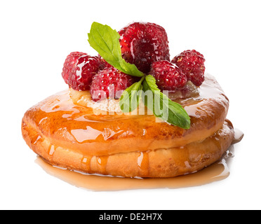 Bun with raspberry and pineapple isolated on a white background