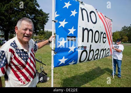 Man holding Anti-Obama banner - Washington, DC USA - Stock Photo