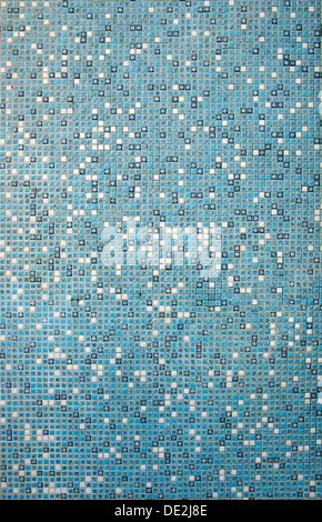 Mosaic wall with small white and turquoise tiles in a swimming pool - Stock Photo