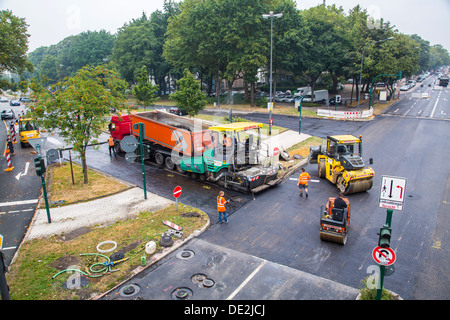 Inner-city road construction site. Asphalted work on a major road junction. New asphalt surface. Alfred Street, - Stock Photo