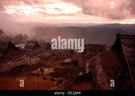 Poverty, evening mood in the mountains, village of the Akha Nuqui ethnic group, thatched huts, Ban Peuyenxangkaw - Stock Photo