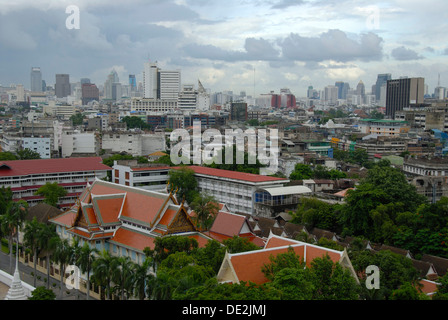 View from the Golden Mountain on the Wat Saket Monastery and the skyscrapers of the metropolis, Bangkok, Thailand - Stock Photo