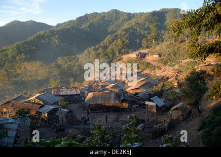 Huts with corrugated iron roofs of the Akha Phixor ethnic group in the mountains, Ban Moxoxang village - Stock Photo