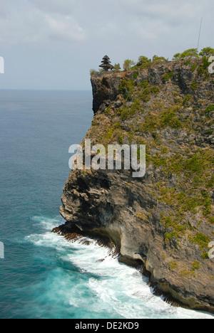 Balinese Hinduism, sanctuary on a cliff high above the sea, small Balinese pagoda, Pura Luhur Uluwatu temple, Bukit - Stock Photo