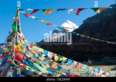 Tibetan Buddhism, Tarboche, a flagpole with colourful prayer flags, in front of the snow-covered holy Mount Kailash, - Stock Photo