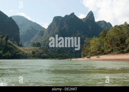 Karst landscape, forested mountains on the Nam Ou River in Muang Ngoi Kao, Luang Prabang province, Laos, Southeast Asia, Asia