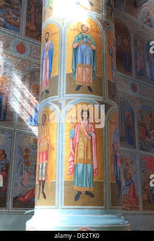 Pillar covered with hand-painted saints inside the Assumption Cathedral of the Kremlin in Kolomna, Russia - Stock Photo