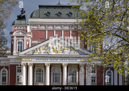Sofia, capital of Bulgaria, Ivan-Vasov-National-Theatre, view from town park, beginning spring with shooting leaves, - Stock Photo