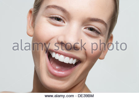 Close up portrait of woman laughing - Stock Photo