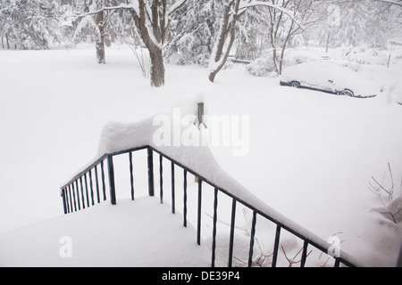 Snow covered front yard of family home - Virginia USA - Stock Photo