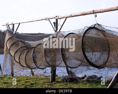 Fishtraps hung to dry, Linfjorden, Denmark - Stock Photo