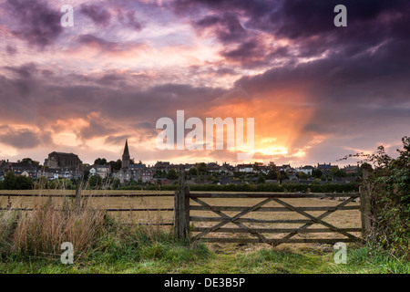 A spectacular sunrise over the Wiltshire hillside town of Malmesbury in September. - Stock Photo