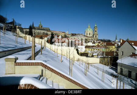 Winter, St. Vitus Cathedral and St. Nicholas church, Prague. Czech Republic - Stock Photo