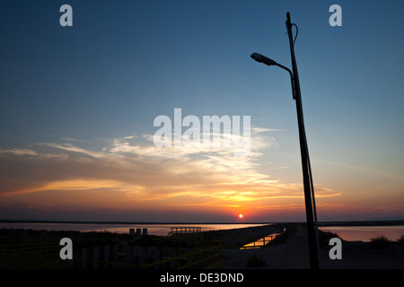Wonderful backlight at sunset with play of tree's shadow in salterns area - Stock Photo