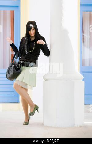 Young woman with a purse - Stock Photo