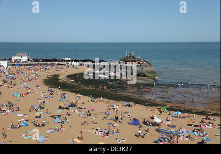 Sunbathers on the hottest day of the year on Broadstairs Viking Bay beach, Kent coast, England - Stock Photo