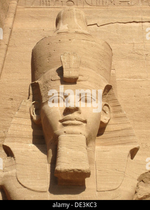 The colossal statue of Ramses II at Abu Simbel, built  as a lasting monument to himself and his wife Queen Nefertari - Stock Photo