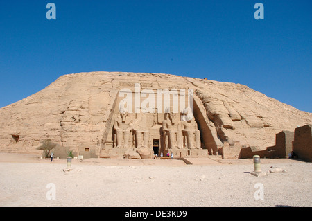 The colossal statues of Ramses II at Abu Simbel, built  as a lasting monument to himself and his wife Queen Nefertari - Stock Photo