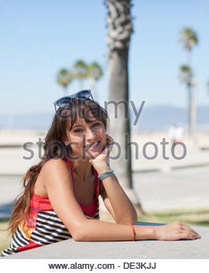 Woman sitting at table in park - Stock Photo