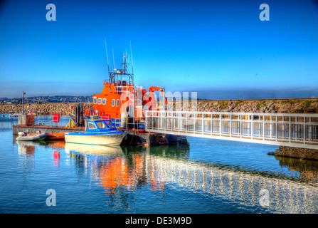 Brixham marina with blue sky and sea, boats and walkway in Devon England Torbay with reflection in HDR - Stock Photo