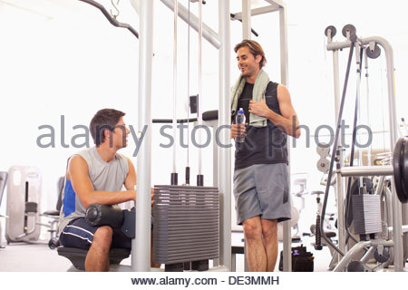 Portrait of smiling men working out in gymnasium - Stock Photo
