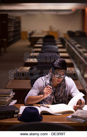 Student working in library - Stock Photo
