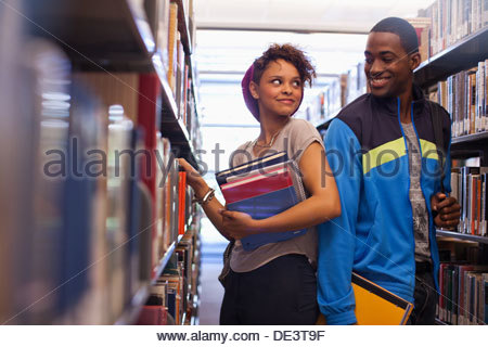 Students talking in library - Stock Photo