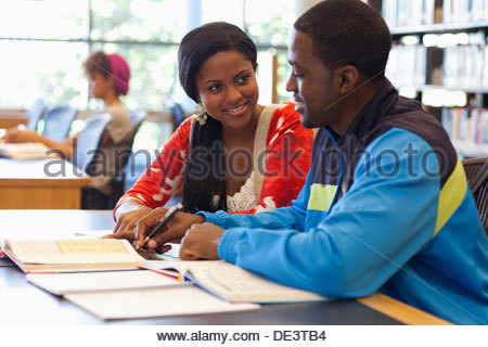 Students in library - Stock Photo