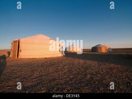 nomadic gers at sunrise in the Gobi Desert of Mongolia - Stock Photo